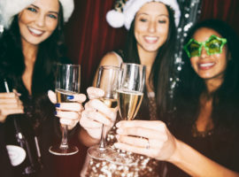 Series of photo booth style images at a holiday party - New Year's and Christmas.