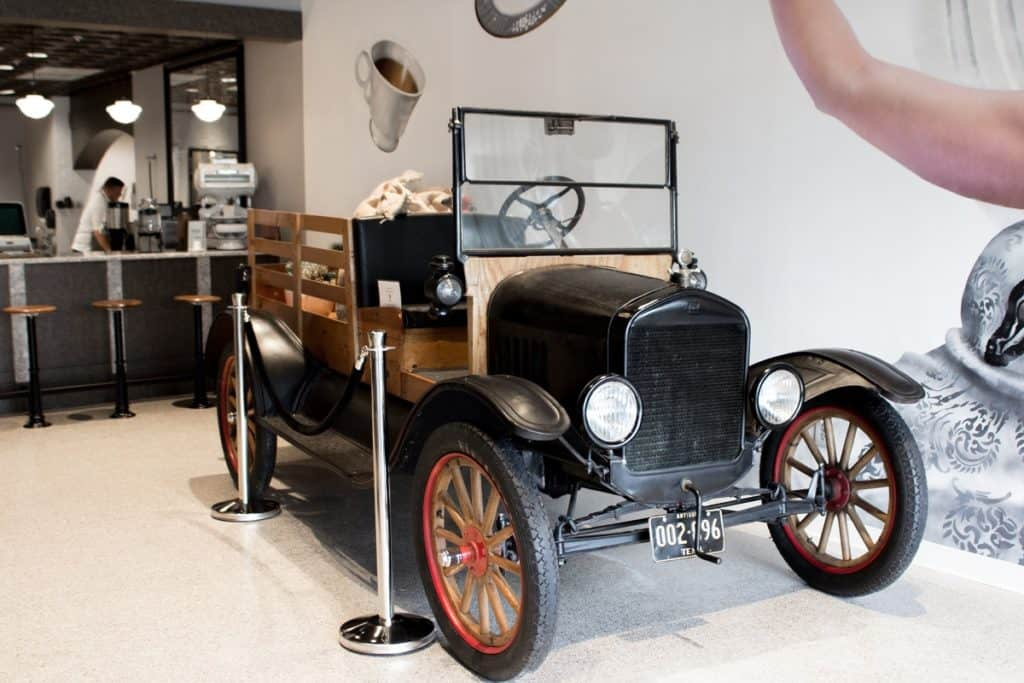 1920's themed coffee shop with Ford Model T and Mural