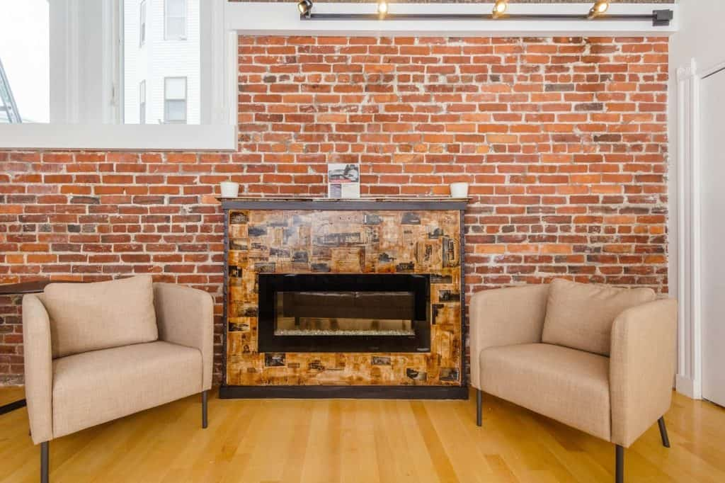 Lounge with Fireplace and Exposed Brick boston rental