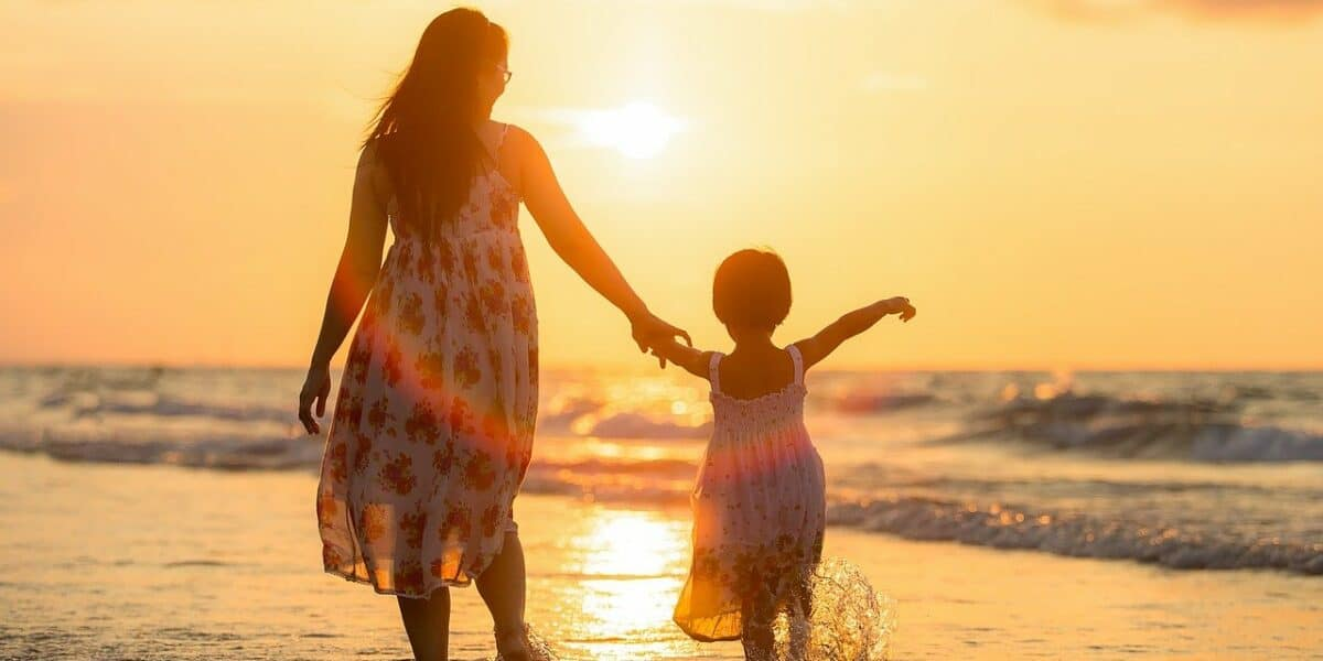 mom and daughter at beach