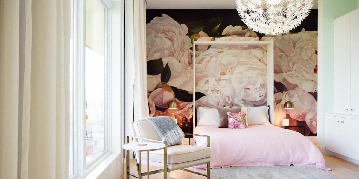 Luxurious Austin bedroom photo shoot location with floral mural, chandelier, and floor to ceiling windows