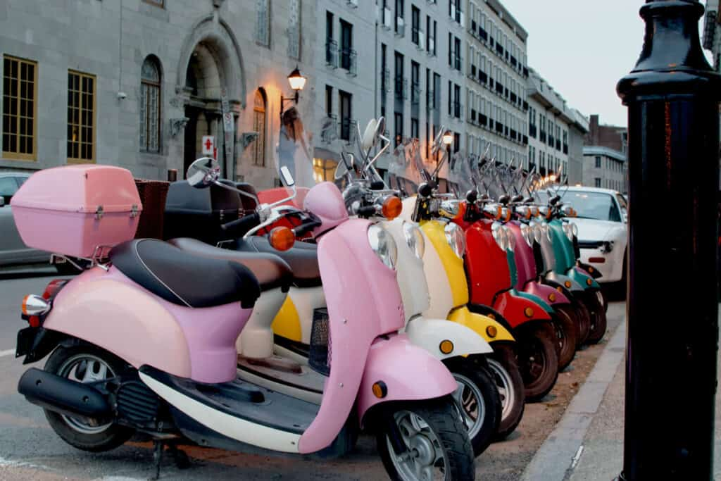 colorful vespa scooters on the street