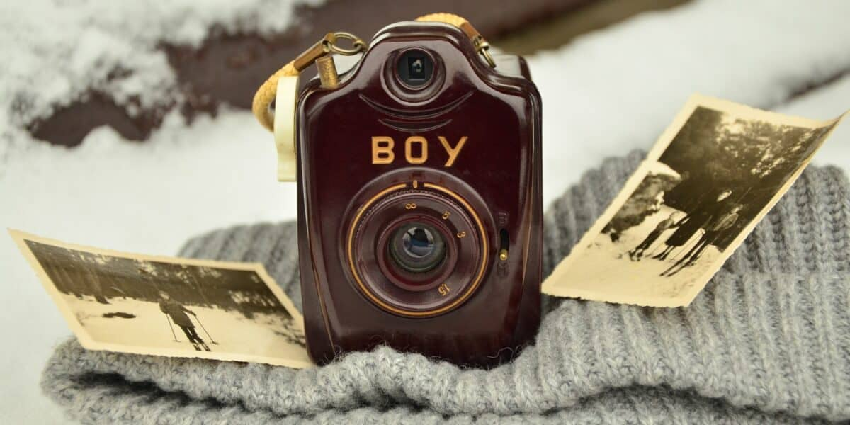 old camera with photographs