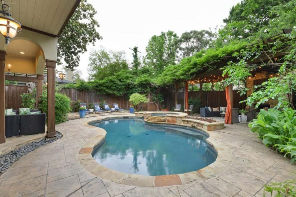 tudor style home with backyard oasis