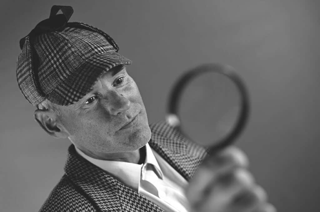 man dressed as detective clue game