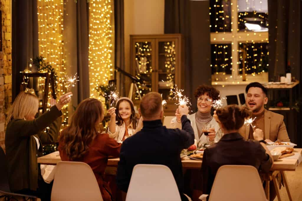 family sitting at holiday table