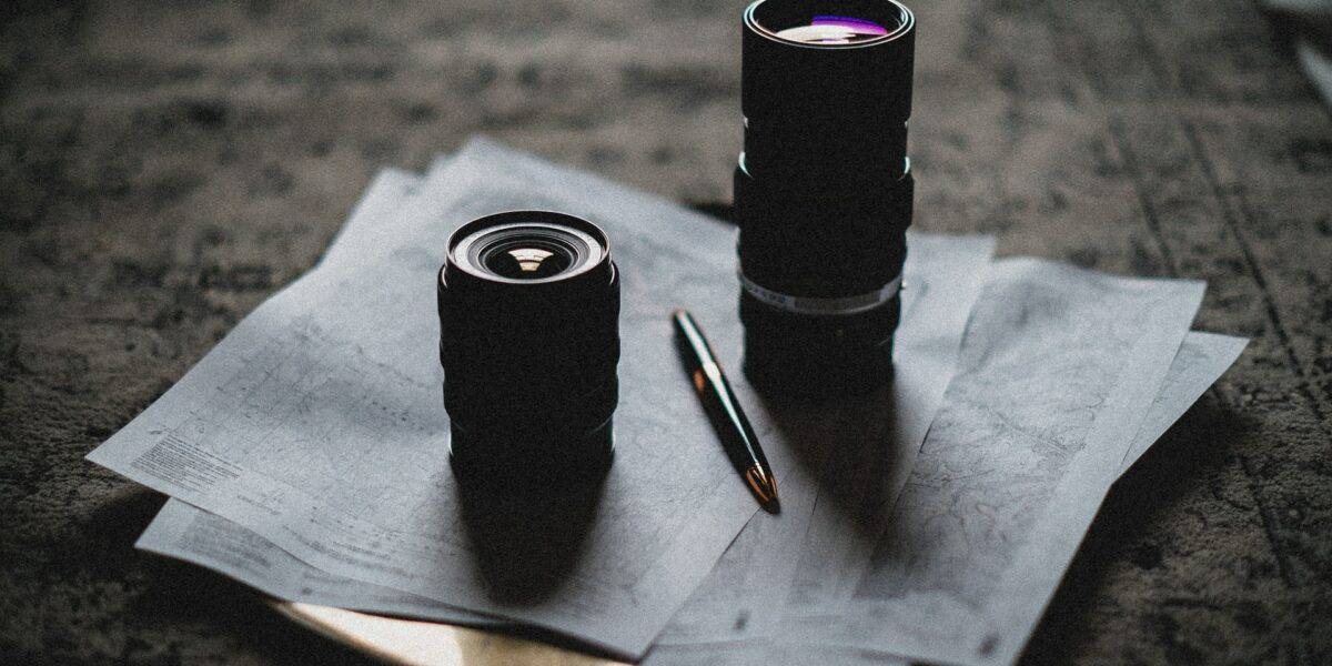 camera lens on top of paper