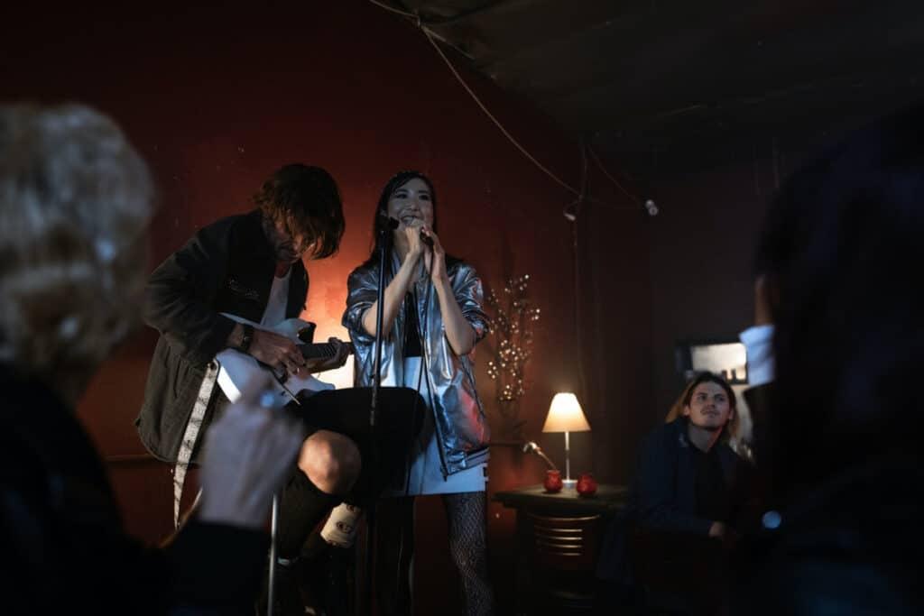 couple performing karaoke songs