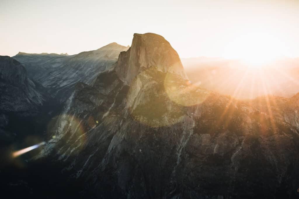 camera lens flare mountainside