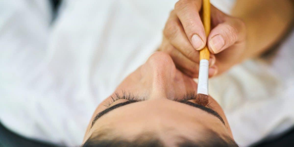 makeup artist applying cosmetics