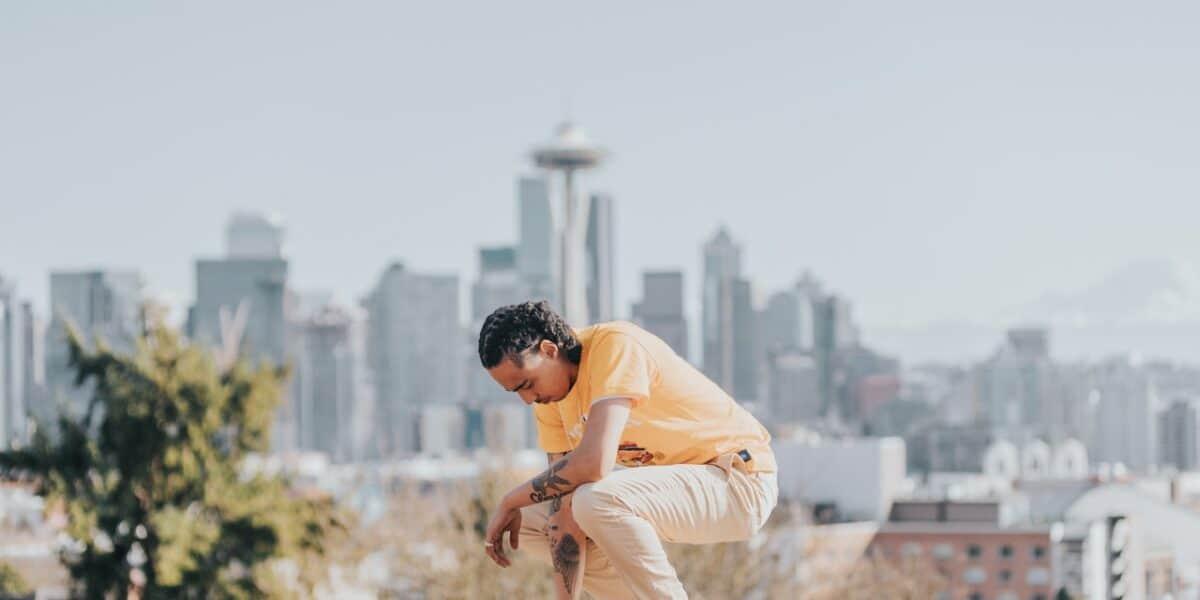 man in front of seattle skyline