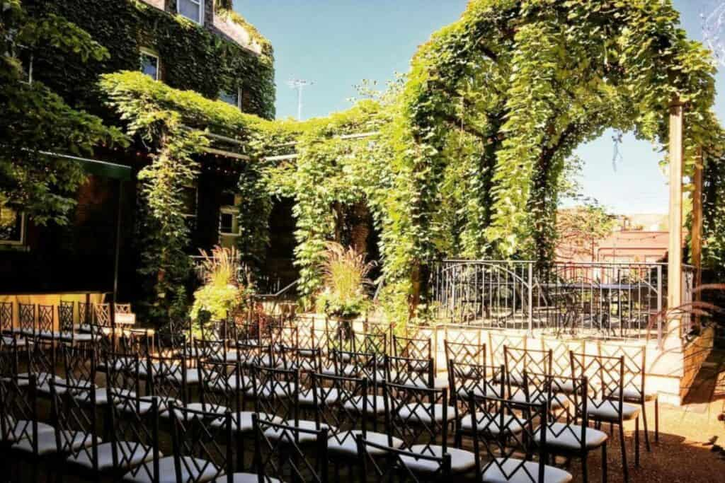 outdoor venue with pergola and greenery